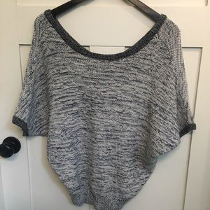 Short sleeve slouchy sweater with scoop neckline.
